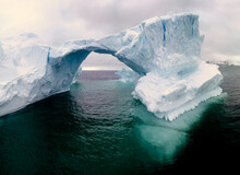 Beautiful Greenland Iceberg Arch Melting, Fractured And About To Crack