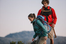 Couple Hiking At Sunset