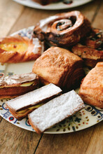 Top Shot Of A Breakfast Brunch Table With Pastries On A Plate
