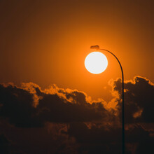 Sunrise With Clouds And Lamppost