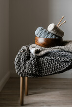 Knitting Tools And Textile On Chair