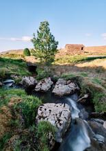 River And Barn At Sunset. Aisgill, Cumbria Yorshire Border, UK.