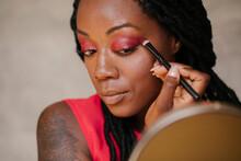 Beautiful Black Woman Applying Make Up