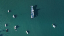 Fishing Vessel Surrounded By Yachts In Pacific Ocean