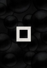 Glowing Square Among Black Matte Balls. Black And White Abstract Illustration