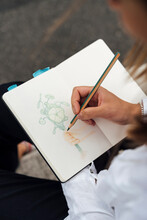 Woman Colouring And Drawing With Pencils