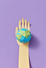 Paper Handmade Earth's Globe On A Craft Hand.