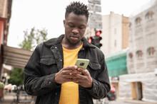 Man Using Cellphone On The Street