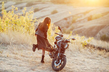 Beautiful Girl Biker In Black Clothes Dancing At The Motorcycle