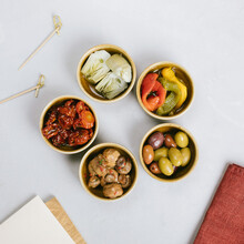 Different Appetizers In Small Bowls