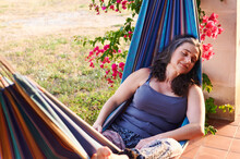 Mature Woman Relaxing In A Hammock