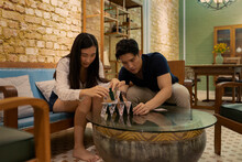 Singaporean Couple Playing Cards At Home During Lockdown