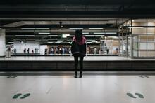 Unrecognizable Woman In Train Station