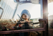 Boy In Window Of Tractor