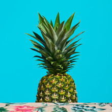 Pineapple On A Floral Background