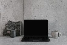 Table With Laptop And Cup Of Coffee In Minimalist Workplace