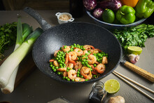 Fried Shrimps With Peas In Pan On Table