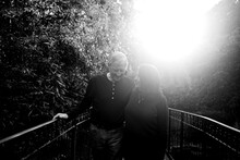 Affectionate Older Couple Spending Time Walking Together In A Pa