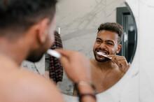 Black Man Cleaning Teeth In Morning