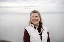 Mature Woman Portrait Outside Near Ocean.