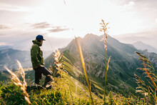 Male Hiker Watching Sunrise In Swiss Mountains