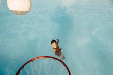 Boy Playing Basketball In Pool.