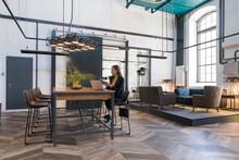 Entrepreneur Working Remotely In A Cozy Cofeteria