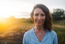 Confident, Content Mature Woman Portrait At Sunset