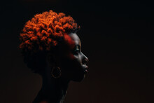 Side View Of African Woman Posing In The Studio