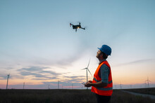 Drone Operated By Construction Worker Inspecting Wind Turbine