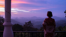 Beautiful Woman Silhouete Looking At Pink And Purple Sky Sunrise With Mountain View