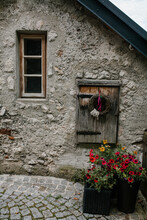 Entrance At The House At The Small Town Grey With Wooden Window And Cute Decor And Red Flowers