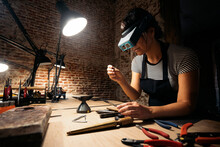 Woman In Artisan Workshop