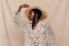 Black Woman In Straw Hat