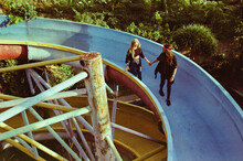 A Guy And A Girl Are Walking In An Abandoned Water Park