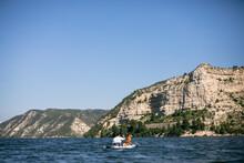 Anonymous Man With Dog Kayaking On Lake