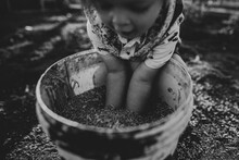Boy With Arms In Grain Bucket