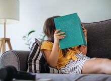Schoolgirl Reading A Book