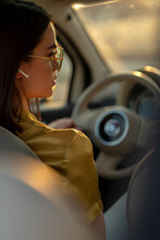 Woman Driving With Hands Free