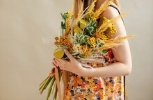Unrecognizable Woman With Bouquet Of Flowers