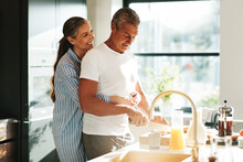 Loving Couple Making Breakfast In The Morning