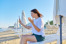 Happy Middle-aged Woman Talking On Smartphone Using Video Call, On Beach