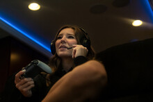 Young Woman Wearing Headset Playing Video Game