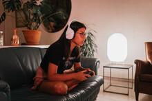 Woman Gaming At Home