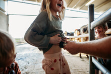 Girl Laughing In A Dairy