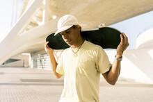 Male Ethnic Skater On City Street