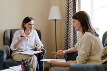 Psychotherapist Speaking With Patient