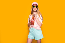 Lovely Woman With Cold Drink Standing On Yellow Background