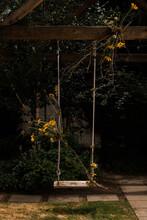 Floral Arrangement On Rustic Swing