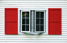 Red Shutters On House